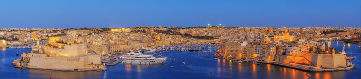 Valetta sunset in Malta. View to Great Harbor at sunset from Upper Barrakka Gardens, Valetta, Malta Royalty Free Stock Photography