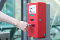 Validate a ticket at a red ticket validation machine for the und Royalty Free Stock Photos
