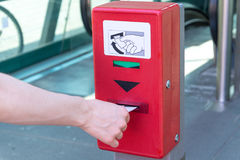 Validate a ticket at a red ticket validation machine for the und Stock Image