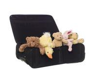 Valigia con gli animali del giocattolo Fotografia Stock