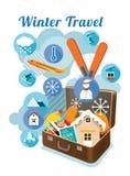 Valigia con gli oggetti e le icone di inverno Fotografie Stock