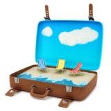 Valigia con una spiaggia Fotografia Stock