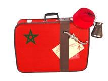 Valigia d'annata con la bandiera del Marocco Fotografia Stock