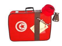Valigia d'annata con la bandiera della Tunisia Fotografie Stock