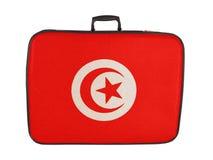Valigia d'annata con la bandiera della Tunisia Fotografia Stock