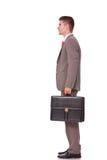 Valigia della holding dell'uomo di affari Immagine Stock Libera da Diritti