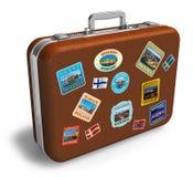 Valigia di cuoio di corsa con i contrassegni Fotografia Stock