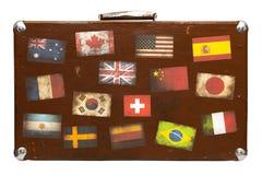 Valigia di viaggio con gli autoadesivi isolati Immagini Stock