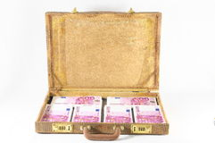 Valigia in pieno delle banconote Immagine Stock