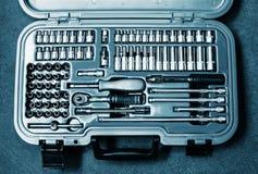 Valigia in pieno di vari strumenti Fotografia Stock Libera da Diritti