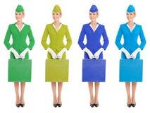 Valise avec du charme d'In Uniform Witn d'hôtesse. Variantes de couleur Photographie stock