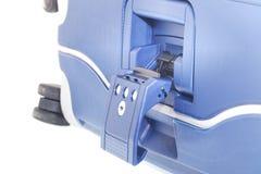 Valise bleue sur des roues Image libre de droits