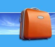 Valise orange lumineuse Images libres de droits