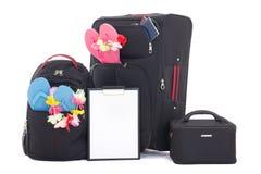 Valises et sac à dos noirs de voyage avec la liste de contrôle d'isolement sur W Photographie stock libre de droits