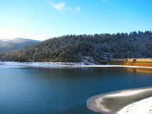 Valiug dam on winter. A man made lake on high altitude Royalty Free Stock Images