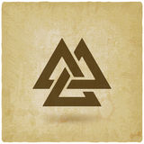 Valknut symbol. interlocked triangles old background Stock Images