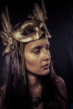 Valkyrie, Golden statue concept. Arty portrait of model with gol Royalty Free Stock Photo