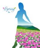 Vallée avec des fleurs sous forme de silhouette femelle Photographie stock libre de droits