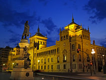 Valladolid scenes (Spain). Statue and old building at night Stock Images