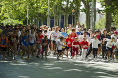 VALLADOLID, SPAIN – SEPTEMBER 2, 2012:. A larger number of runners all ages break from the starting line at the beginning of the popular race during the Stock Photography