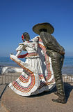 Vallarta Dancers Puerto Vallarta Mexico. Statue of the Vallarta Dancers stands under a clear blue sky on El Malecon in Puerto Vallarta Mexico Royalty Free Stock Photography