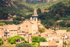 Valldemossa beautifuls streets. View of the church in the city center royalty free stock photo