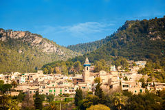 Valldemossa with the mountains on the background Royalty Free Stock Images