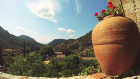 Valldemossa view. Big clay jug in a garden with a view on Valldemossa village in Mallorca, Balearic islands, Spain stock footage