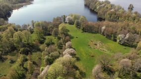 Valle Area Famous For Thousands Of Wild Cherry Blossom Trees And Lake, Pull Back Aerial