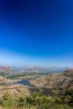 Valle, camino y ciudad de la montaña Imágenes de archivo libres de regalías