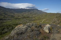 Valle Chacabuco in northern Patagonia, Chile. Landscape of snow capped mountains and green hills in Valle Chacabuco in northern Patagonia, Chile Royalty Free Stock Photo