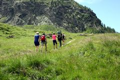 Valle d`Aosta, Italy, August 19 2018: group of hikers walking on italian alps. Valle d`Aosta, Italy, August 19 2018: group of hikers  on italian alps Stock Photography