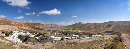 Valle de Femes in Lanzarote. Lanzarote - Panorama over the village Femes and the valley Valle de Femes during the ascent to the mountain Atalaya de Femes. On the Royalty Free Stock Images