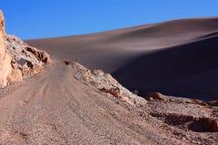 Valle de la Luna. Dust road and duen at the entrance of Valle del la Luna in Bolivia Stock Images