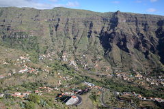 VALLE GRAN REY, LA GOMERA, SPAIN: General view of the valley with terraced fields and mountains. Winding road in the foreground. General view of the valley with stock photo
