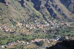 VALLE GRAN REY, LA GOMERA, SPAIN: General view of the valley with terraced fields and mountains. Winding road in the foreground. General view of the valley with stock photos