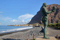 VALLE GRAN REY, LA GOMERA, SPAIN - MARCH 19, 2017: La Playa beach in La Puntilla with the statue of Hautacuperche in the foregroun stock photography