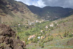 VALLE GRAN REY, LA GOMERA, SPAIN: Mountainous and green landscape with terraced fields and palm trees royalty free stock photography