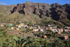 VALLE GRAN REY, LA GOMERA, SPAIN: View of Chele village with terraced fields and mountains royalty free stock photography