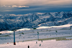 Valle Nevado. Breathtaking view of skiers and beautiful mountains at sunset in Valle Nevado Stock Photos