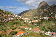 VALLEHERMOSO, LA GOMERA, SPAIN: General view of the valley with terraced fields and Roque Cano in the background. General view of the valley with terraced fields royalty free stock images