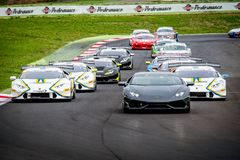 Vallelunga, Italy september 24 2017. Group of touring racing car. S, Lamborghini Porsche and Ferrari behind safety car during race formation lape stock image
