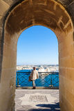 Vallera old fortress Malta. Europe. Tourist looking at the old Valleta city walls and naval fortress Stock Image