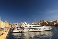 Valletta bay. Beautiful yacht on the pier in Valletta port, Malta Royalty Free Stock Photo