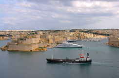 Valletta, the capital of Malta and Mediterranean sea. Beautiful view to maltese city and ancient fortress and buildings surrounded by Mediterranean sea with Stock Photo