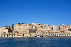 Valletta city buildings and harbour, Malta. Valletta waterfront buildings including Upper Barrakka Gardens seen from across the Grand Harbour in Vittoriosa Royalty Free Stock Photo
