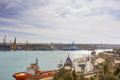 Valletta city harbor area at Malta, with many historic buildings along the coastline.  Royalty Free Stock Photography
