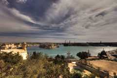 Valletta city harbor area at Malta, with many historic buildings along the coastline.  Royalty Free Stock Photos