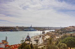 Valletta city harbor area at Malta, with many historic buildings along the coastline.  Royalty Free Stock Images