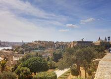 Valletta city harbor area at Malta, with many historic buildings along the coastline.  Royalty Free Stock Photo